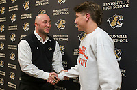 NWA Democrat-Gazette/CHARLIE KAIJO Coach James Rappe shakes hands with Cash Jones after he signed his college letter of intent on Thursday, November 9, 2017 at Bentonville High School in Bentonville. Cash Jones signed his national letter of intent with Campbell University, an NCAA Division I school in North Carolina.