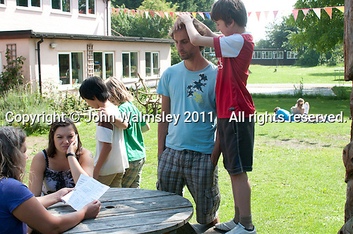 Hanging out in the grounds, Summerhill School, Leiston, Suffolk. The school was founded by A.S.Neill in 1921 and is run on democratic lines with each person, adult or child, having an equal say.  You don't have to go to lessons if you don't want to but could play all day.  It gets above average GCSE exam results.