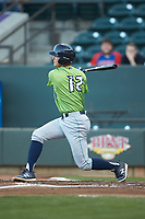 Luke Wakamatsu (12) of the Lynchburg Hillcats follows through on his swing against the Winston-Salem Dash at BB&T Ballpark on May 1, 2018 in Winston-Salem, North Carolina. The Dash defeated the Hillcats 9-0. (Brian Westerholt/Four Seam Images)