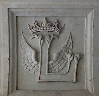 Emblem of Fontevraud, a winged 'L' surmounted by the royal crown of Louise de Bourbon, Abbess of Fontevraud 1534-75. She left her monogram on the Abbey walls where the buildings were improved during her time as Abbess, decorative plaque from Chapter House, Fontevraud Abbey, Fontevraud-l'Abbaye, Loire Valley, Maine-et-Loire, France. The abbey was founded in 1100 by Robert of Arbrissel, who created the Order of Fontevraud. It was a double monastery for monks and nuns, run by an abbess. Picture by Manuel Cohen