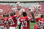 The Wisconsin Badgers football team raise their helmets at the start of an NCAA college football game against the San Jose State Spartans on September 11, 2010 in Madison, Wisconsin. The Badgers beat San Jose State 27-14. (Photo by David Stluka)