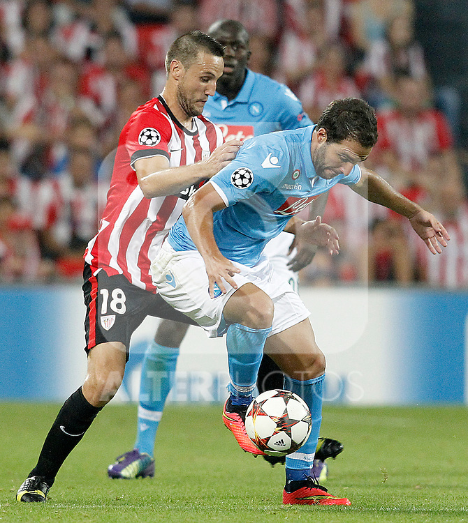 Athletic de Bilbao's Carlos Gurpegi (l) and SSC Napoli's Gonzalo Higuain during Champions League 2014/2015 Play-off 2nd leg match.August 27,2014. (ALTERPHOTOS/Acero)