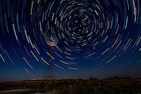 Startrails forming around the North Star above a windmill in the Cimarron National Grassland near Elkhart Kansas.
