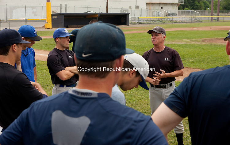 TORRINGTON, CT- MAY 29, 2010-052910JS03-Torrington Titans manager Gregg Hunt talks with his players during opening day of practice Saturday at Fuessenich Park in Torrington. The Titans will host an open tryout for all college-eligible players on Memorial Day, Monday, May 31, beginning at 10 a.m. at Wamogo Regional High School in Litchfield. Their first game is scheduled for June 3, against North Jersey at 7 p.m. at Fuessenich Park.<br /> Jim Shannon Republican-American