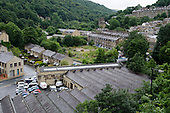 Ex-industrial buildings and housing in Hebden Bridge, West Yorkshire.  The town used to be a centre for the wool trade, weaving and clothing manufacture, but is now reliant on tourism, with many residents commuting to larger towns and cities nearby to find employment.