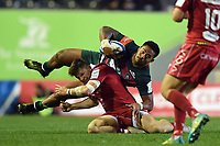 Manu Tuilagi of Leicester Tigers is tackled by Steff Evans of the Scarlets. Heineken Champions Cup match, between Leicester Tigers and the Scarlets on October 19, 2018 at Welford Road in Leicester, England. Photo by: Patrick Khachfe / JMP