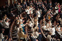 Washington DC, February 5, 2019, USA: Women Congressional Representatives cheer as President Trump congradulated them on their victory. President Donald J Trump gives his second State of the Union (SOTU) address as President.  House Speaker Nancy Pelosi and Vice President Mike Pence sit behind him in the US Capitol House of Representatives.<br /> CAP/MPI/PYL<br /> ©PYL/MPI/Capital Pictures