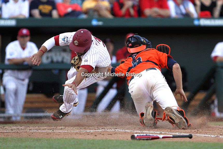 South Carolina's Adrian Morales is tagged out at home by Virginia catcher John Hicks in the fourth inning. South Carolina beat Virginia 3-2 in 13 innings at the College World Series on June 24, 2011 in Omaha, Neb. (Photo by Michelle Bishop)..