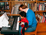 Child with grandmother at piano