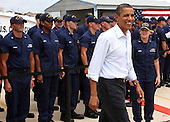 United States President Barack Obama answers questions from reportes after speaking at a Coast Guard base in Panama City, Florida USA on Saturday, 14 August  2010. The First Family is visiting the area to help promote tourism and check up on clean up efforts from the aftermath of the Deepwater Horizon Oil spill.  .Credit: Dan Anderson / Pool via CNP