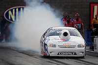 Oct. 31, 2008; Las Vegas, NV, USA: NHRA pro stock driver Ron Krisher does a burnout during qualifying for the Las Vegas Nationals at The Strip in Las Vegas. Mandatory Credit: Mark J. Rebilas-