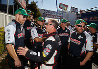 Feb 14, 2016; Pomona, CA, USA; NHRA top fuel driver Steve Torrence (center) with crew members during the Winternationals at Auto Club Raceway at Pomona. Mandatory Credit: Mark J. Rebilas-USA TODAY Sports