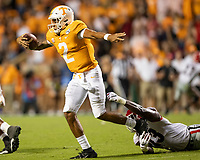 KNOXVILLE, TN - OCTOBER 5: Jarrett Guarantano #2 of the Tennessee Volunteers attempts to escape the grasp of Azeez Ojulari #13 of the Georgia Bulldogs during a game between University of Georgia Bulldogs and University of Tennessee Volunteers at Neyland Stadium on October 5, 2019 in Knoxville, Tennessee.