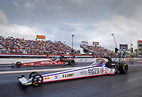 Apr 27, 2014; Baytown, TX, USA; NHRA top fuel dragster driver Antron Brown (near) races alongside teammate Spencer Massey during the Spring Nationals at Royal Purple Raceway. Mandatory Credit: Mark J. Rebilas-USA TODAY Sports