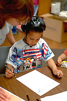 Boy age 5 filling out Youth Express Bicycle Safety Rodeo safety form.  St Paul  Minnesota USA