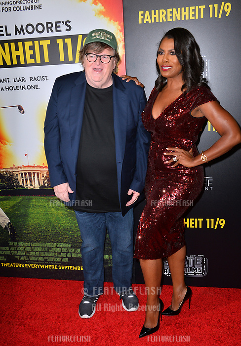 "LOS ANGELES, CA. September 19, 2018: Michael Moore & Omarosa Manigault Newman at the Los Angeles premiere for Michael Moore's ""Fahrenheit 11/9"" at the Samuel Goldwyn Theatre.<br /> Picture: Paul Smith/Featureflash"