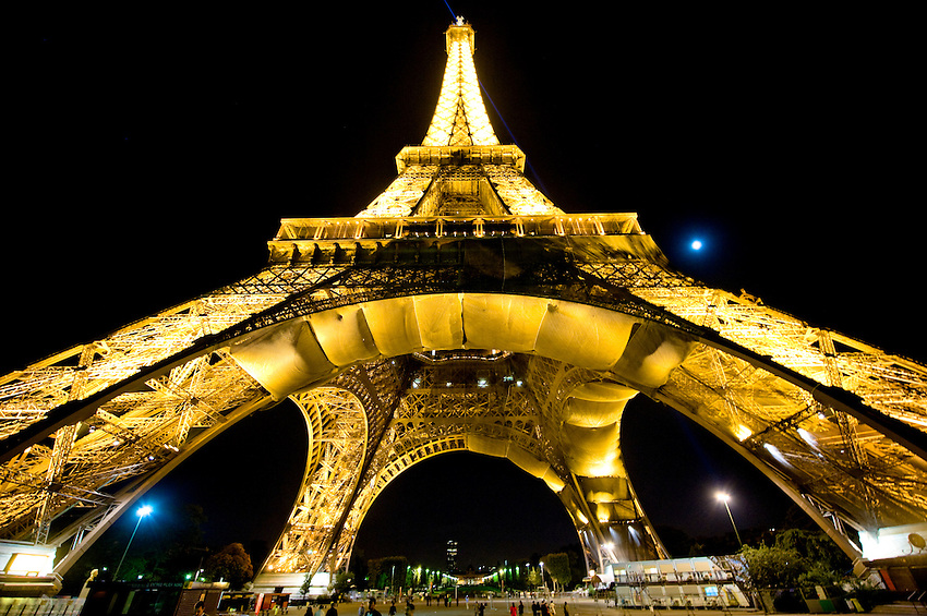 Eiffel Tower at night on the Champ de Mars in Paris, France.