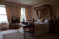 One of the bedrooms with painted panelling at Tarbert House