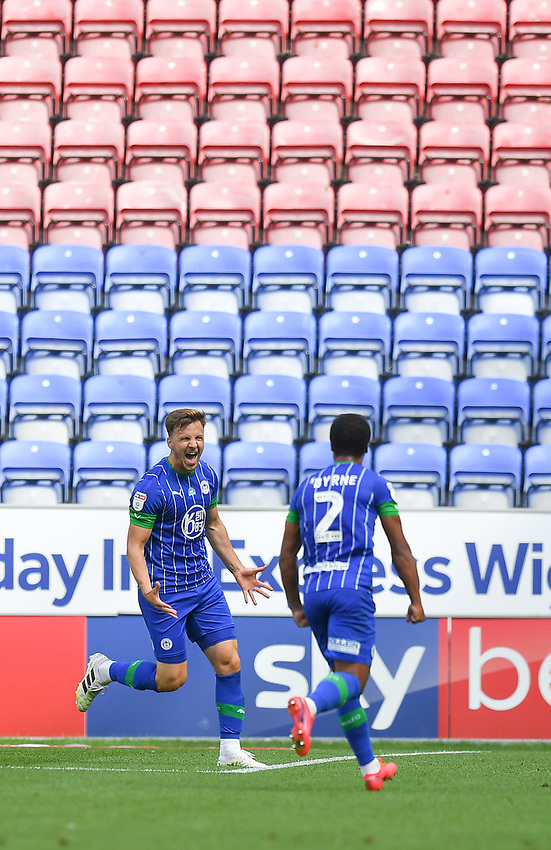 Wigan Athletic's Lee Evans celebrates his team's opening goal<br /> <br /> Photographer Dave Howarth/CameraSport<br /> <br /> The EFL Sky Bet Championship - Wigan Athletic v Blackburn Rovers - Saturday 27th June 2020 - DW Stadium - Wigan<br /> <br /> World Copyright © 2020 CameraSport. All rights reserved. 43 Linden Ave. Countesthorpe. Leicester. England. LE8 5PG - Tel: +44 (0) 116 277 4147 - admin@camerasport.com - www.camerasport.com