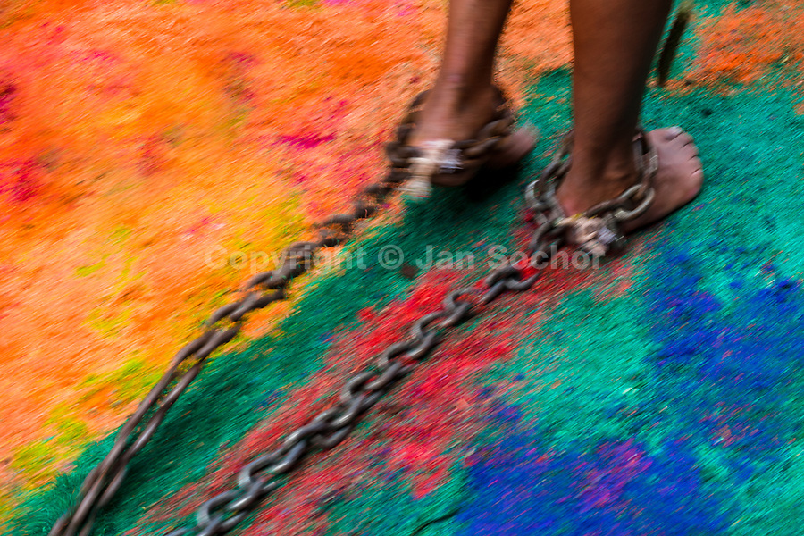 A Catholic penitent, with cactus spines stuck to his leg, drags chains on a colorful sawdust carpet during the Holy week procession in Atlixco, Mexico, 30 March 2018. Every year on Good Friday, dozens of anonymous men of all ages voluntarily undergo pain and suffering during the religious procession of the 'Engrillados' (the Shackled ones) in Puebla state, central Mexico. Wearing heavy chains on their shoulders covered with prickling cacti while being burned by the hot midday sun, they recall Jesus Christ's death by crucifixion and demonstrate their religiosity and faith.