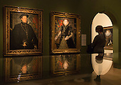 "A visitor stands in front of the paintings ""Thomas Howard, 4th Duke of Norfolk"" by Hans Eworth and ""Margaret Dudley, Duchess of Norfolk"" by Hans Eworth, 1562. Press preview of the exhibition ""Elizabeth I & Her People"" at the National Portrait Gallery which explores the remarkable reign of Elizabeth I through the lives and portraiture of her subjects. Exhibition runs from 10 October 2013 to 5 January 2014."