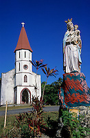 Statue of the Virgin Mary and baby Jesus outside an old missionary church, New Caledonia.