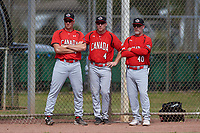 Canada Junior National Team coaches Scott Mathieson (47), Pete Orr (4), and Andy Stewart (40) during an exhibition game against the Toronto Blue Jays on March 8, 2020 at Baseball City in St. Petersburg, Florida.  (Mike Janes/Four Seam Images)