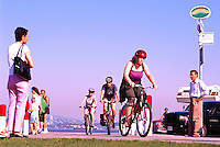 Stanley Park, Vancouver, BC, British Columbia, Canada - Cyclists cycling and Tourists standing on Seawall at Brockton Point, in Summer