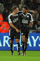 Riyad Mahrez of Leicester City (R) celebrates his third goal with team mate Danny Drinkwater (L) during the Barclays Premier League match between Swansea City and Leicester City at the Liberty Stadium, Swansea on December 05 2015