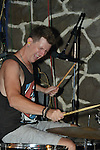 Kaohsiung, Taiwan -- Drummer Tim Hardwick of British Rock 'n' Roll band GOOBER GUN during a performance at the Brickyard.