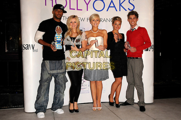 RICKY WHITTLE, CARLEY STENSON, GEMMA MERNA, EMMA RIGBY & KIERON RICHARDSON.Attend the launch of the Hollyoaks Perfume at The Eve Club, London, England..September 30th, 2008 .fragrance full length jeans denim black leggings dress white strapless grey gray pattern top belt baseball cap hat .CAP/CAS.©Bob Cass/Capital Pictures.