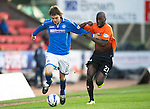 St Johnstone v Dundee United.....29.12.13   SPFL<br /> Murray Davidson fends of Morgaro Gomis<br /> Picture by Graeme Hart.<br /> Copyright Perthshire Picture Agency<br /> Tel: 01738 623350  Mobile: 07990 594431