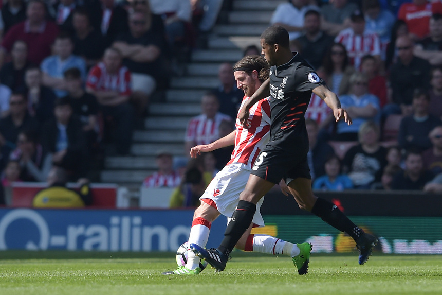 Stoke City's Joe Allen battles with  Liverpool's Georginio Wijnaldum<br /> <br /> Photographer Terry Donnelly/CameraSport<br /> <br /> The Premier League - Stoke City v Liverpool - Saturday 8th April 2017 - bet365 Stadium - Stoke-on-Trent<br /> <br /> World Copyright &copy; 2017 CameraSport. All rights reserved. 43 Linden Ave. Countesthorpe. Leicester. England. LE8 5PG - Tel: +44 (0) 116 277 4147 - admin@camerasport.com - www.camerasport.com