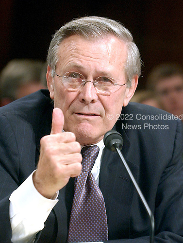 Washington, D.C. - March 23, 2004 -- United States Secretary of Defense Donald H. Rumsfeld testifies before The National Commission on Terrorist Attacks Upon the United States (also known as the 9-11 Commission) in Washington, D.C. on March 23, 2004.<br /> Credit: Ron Sachs / CNP<br /> [RESTRICTION: No New York Metro or other Newspapers within a 75 mile radius of New York City]