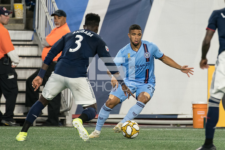 FOXBOROUGH, MA - SEPTEMBER 29: Ismael Tajouri-Shradi #29 of New York City FC dribbles around Jalil Anibaba #3 of New England Revolution during a game between New York City FC and New England Revolution at Gillettes Stadium on September 29, 2019 in Foxborough, Massachusetts.