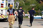 Three firefighter emts running for an emergency