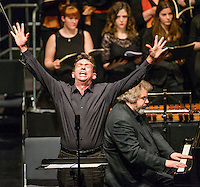 German Baritone Peter Schüler sings in a concert.