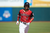 Pedro Gonzalez (4) of the Hickory Crawdads rounds the bases after hitting a home run against the Greensboro Grasshoppers at L.P. Frans Stadium on May 26, 2019 in Hickory, North Carolina. The Crawdads defeated the Grasshoppers 10-8. (Brian Westerholt/Four Seam Images)