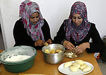 A Palestinian family prepares Bread traditional from Potatoes, at their house in town of Khan Yunis, southern Gaza Strip on February 2, 2012. Palestinian families used some of the manufacture of potato bread instead of the traditional bread of flour. Equal to a kg of flour, $ 1.5. And a kg of potatoes $ 0.5. Israel maintains a tight blockade on the Palestinian territory building into Gaza since Islamist Hamas took control over the Palestinian territory in 2007 Photo by Abed Rahim Khatib