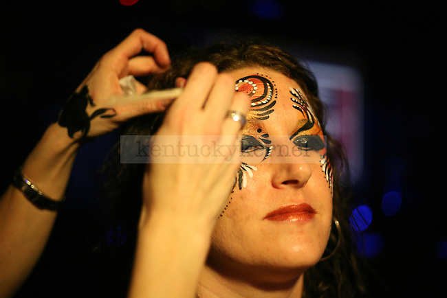 April Johnson, from Bellefontaine, Ohio, gets her face painted at Cosmic Charlie's nightclub during the Whiskey, Whiskers and Women event in Lexington, Ky. Jan. 31, 2012. Photo by Brandon Goodwin | Staff