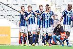 Stockholm 2014-04-06 Fotboll Allsvenskan Djurg&aring;rdens IF - Halmstads BK :  <br /> Djurg&aring;rdens Martin Broberg har gjort 1-0 och gratuleras av Djurg&aring;rdens Alexander Faltsetas  , Djurg&aring;rdens Emil Bergstr&ouml;m med lagkamrater<br /> (Foto: Kenta J&ouml;nsson) Nyckelord:  Djurg&aring;rden DIF Tele2 Arena Halmstad HBK jubel gl&auml;dje lycka glad happy