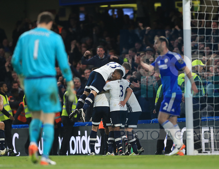 Tottenham's players celebrate their sides second goal during the Barclays Premier League match at Stamford Bridge Stadium.  Photo credit should read: David Klein/Sportimage