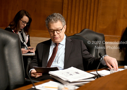 United States Senator Al Franken (Democrat of Minnesota) looks over his notes prior to hearing Alex M. Azar II testify before the US Senate Committee on Health, Education, Labor and Pensions on his nomination to be Secretary of Health and Human Services on Capitol Hill in Washington, DC on Wednesday, November 29, 2017.<br /> Credit: Ron Sachs / CNP