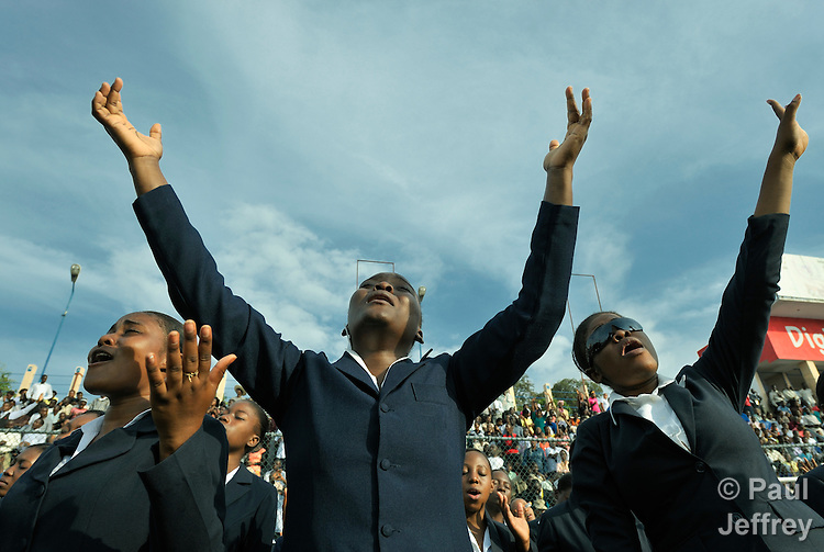 Just before the one-year anniversary of the January 2010 earthquake that ravaged Port-au-Prince, Haiti, this woman joined with thousands of others in the capital's soccer stadium for a religious gathering that featured Franklin Graham, the conservative U.S. evangelical leader.