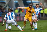 Preston North End's Marnick Vermijl is tackled by Huddersfield Town's Nahki Wells<br /> <br /> Photographer Alex Dodd/CameraSport<br /> <br /> The EFL Sky Bet Championship - Huddersfield Town v Preston North End - Friday 14th April 2016 - The John Smith's Stadium - Huddersfield<br /> <br /> World Copyright &copy; 2017 CameraSport. All rights reserved. 43 Linden Ave. Countesthorpe. Leicester. England. LE8 5PG - Tel: +44 (0) 116 277 4147 - admin@camerasport.com - www.camerasport.com