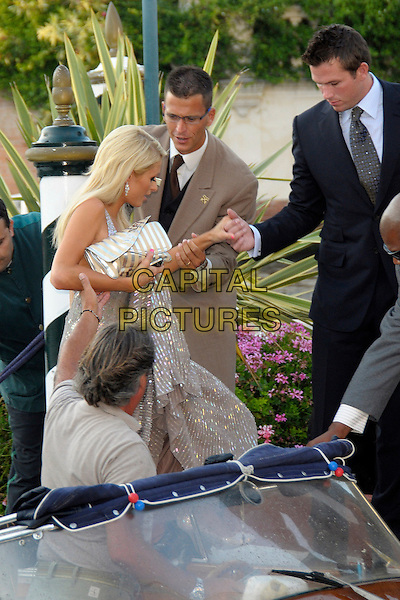 "PARIS HILTON & DOUG REINHARDT .At the ""Bad Lieutenant: Port Of Call New Orleans""  film premiere during the .66th Venice International Film Festival, Palazzo del Casino, Lido, Venice, Italy, .4th September 2009..half length silver dress clutch bag  suit black tie sequined shiny couple boyfriend holding hands getting off boat arriving .CAP/RD .©Richard Dean/Capital Pictures"