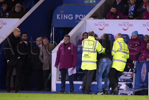 19th December 2017, King Power Stadium, Leicester, England; Carabao Cup quarter-final, Leicester City versus Manchester City; A Leicester City fan is quickly apprehended by stewards as he tries to get to Pep Guardiola manager of Manchester City