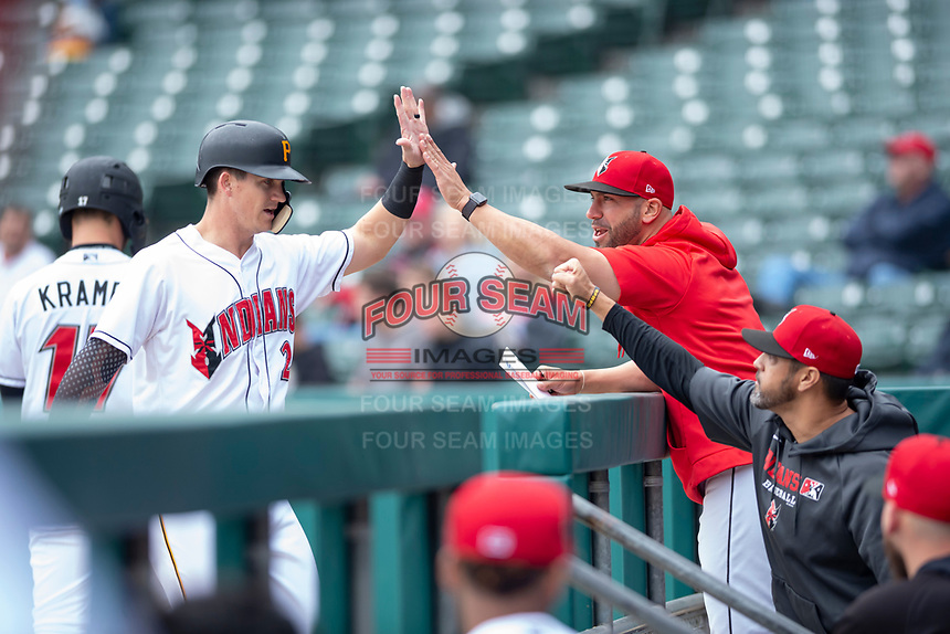 Indianapolis Indians left fielder Kevin Newman (2) is congratulated by manager Brian Esposito (5) and hitting coach Ryan Long (29) after scoring a run during an International League game against the Columbus Clippers on April 30, 2019 at Victory Field in Indianapolis, Indiana. Columbus defeated Indianapolis 7-6. (Zachary Lucy/Four Seam Images)