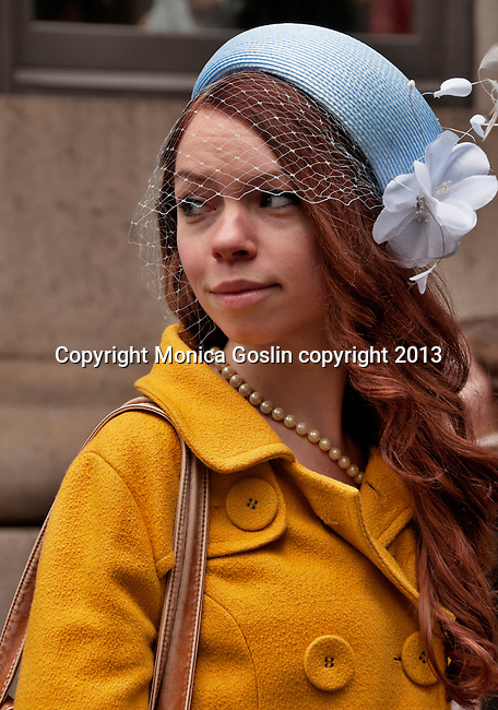 A woman wears a delicate hat with a net across her face to the Easter Parade in New York City on Fifth Avenue