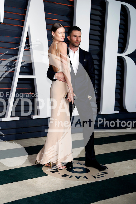 Behati Prinsloo and Adam Levine attending the Vanity Fair Oscar Party 2015 on February 22, 2015 in Beverly Hills, California.